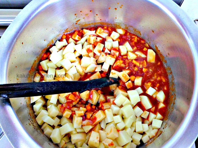 adding potatoes shortly after the carrots allows them to cook together and not become too mushy_pea and potato stew by kaluhis kitchen