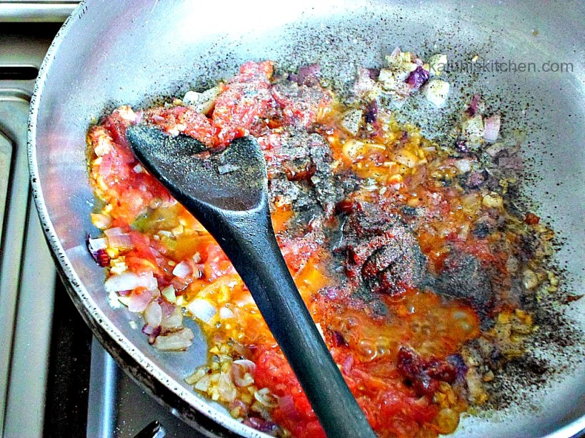 allow tomato paste to cook for afew minutes for it to break down well and remove that metallic taste it inherently has while raw