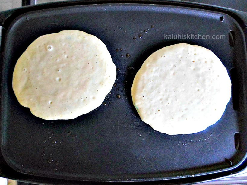 orange zest funfetti pancakes simmeering on low heat to get the perfect browness_Kaluhis Kitchen