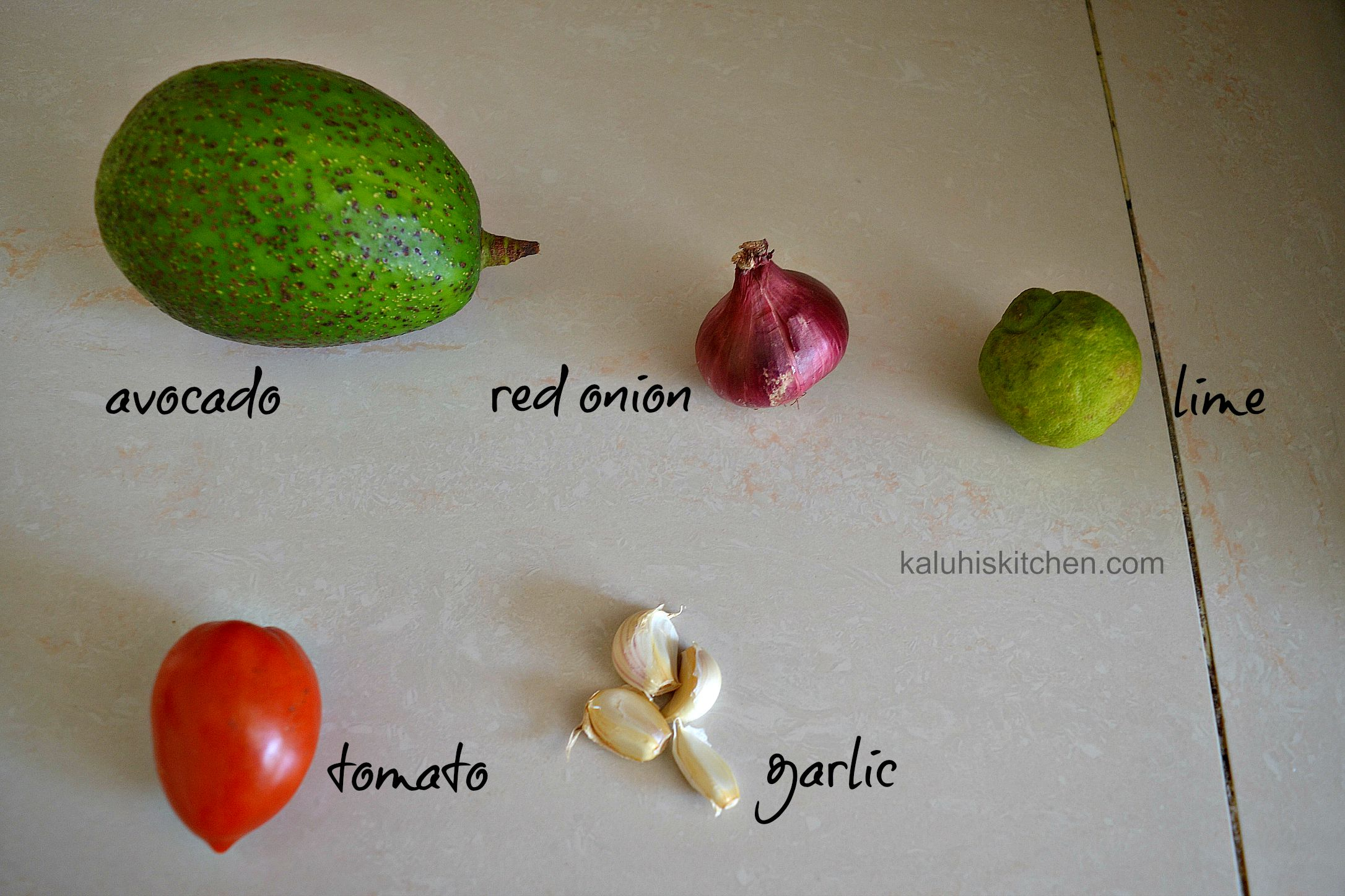 ingredients for the onion and lime guacamole by kaluhi adagala of kaluhiskitchen.com
