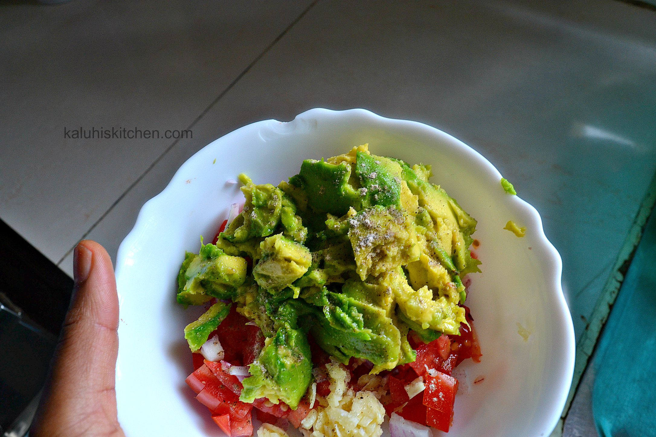 salt is a necessary ingredient to the guacamole as it brings out the flavor of the avocado, brings out the juices of the tomato_kaluhiskitchen.com