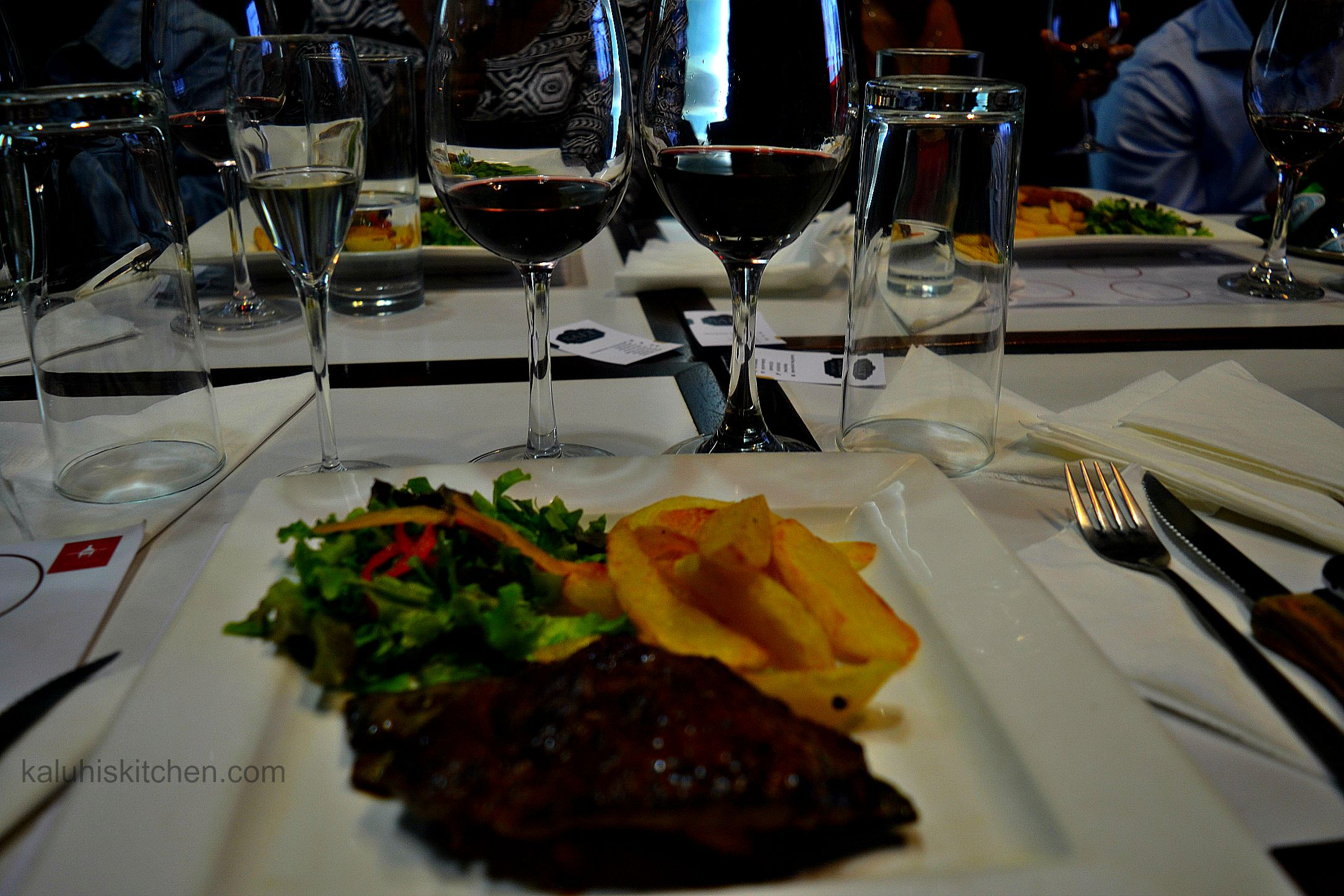 wine at the salt bar and grill served with their phenomenal juicy steak with fries and a vinegrette salad