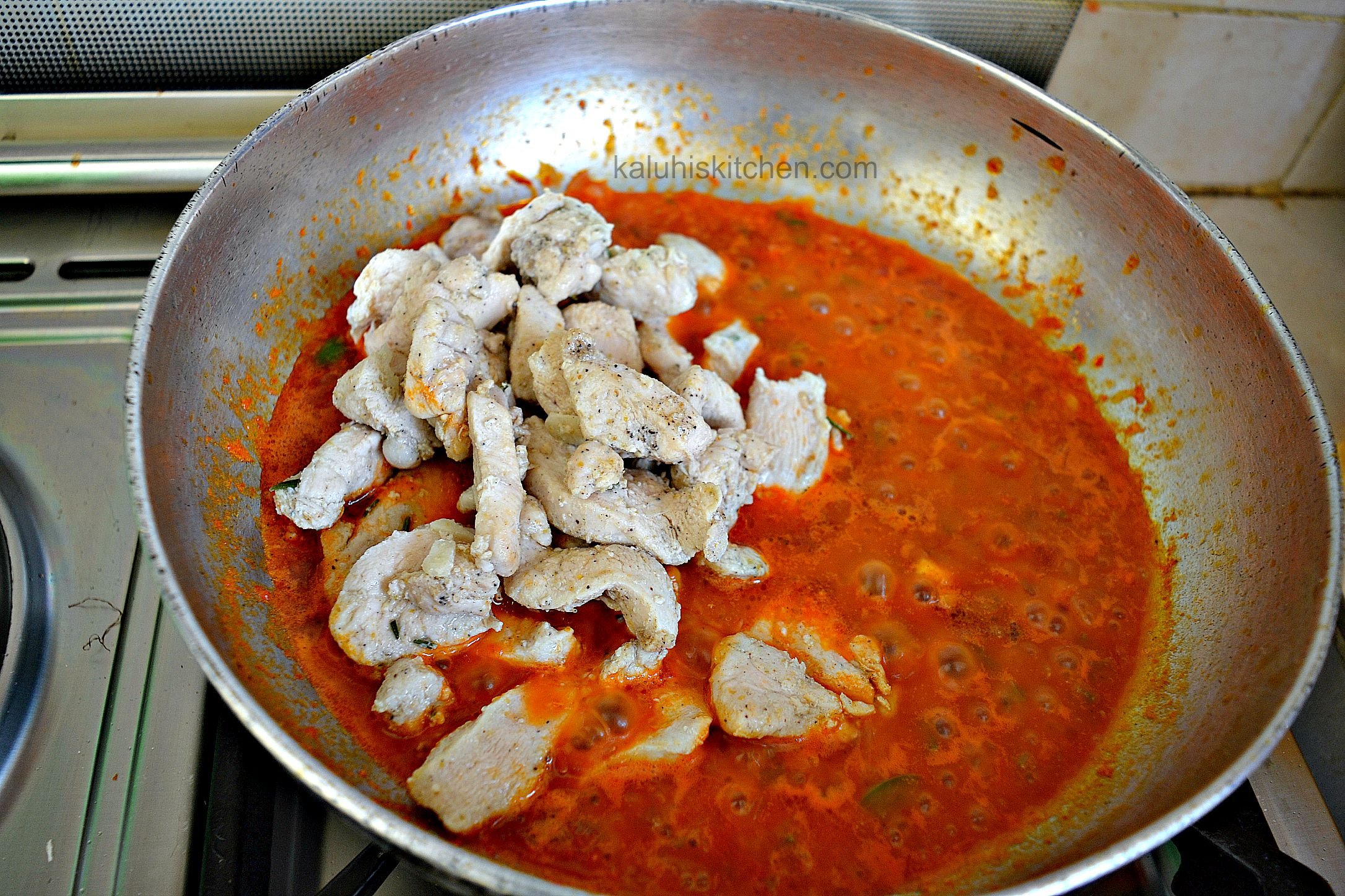 add the chicken to the orange and ginger sauce after they are almost done and let them simmer down in the sauce_kaluhiskitcken.com_saucy orange and ginger chicken