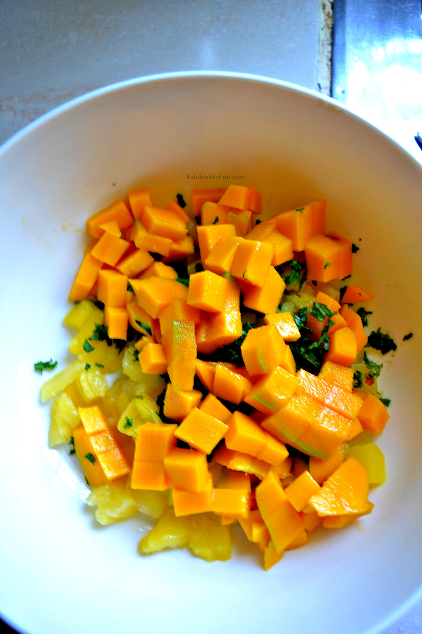 ad the mango nad mix it in with the pineapple and mint and allow it to sit for a while_mango mint salad_how to make mango mint salad