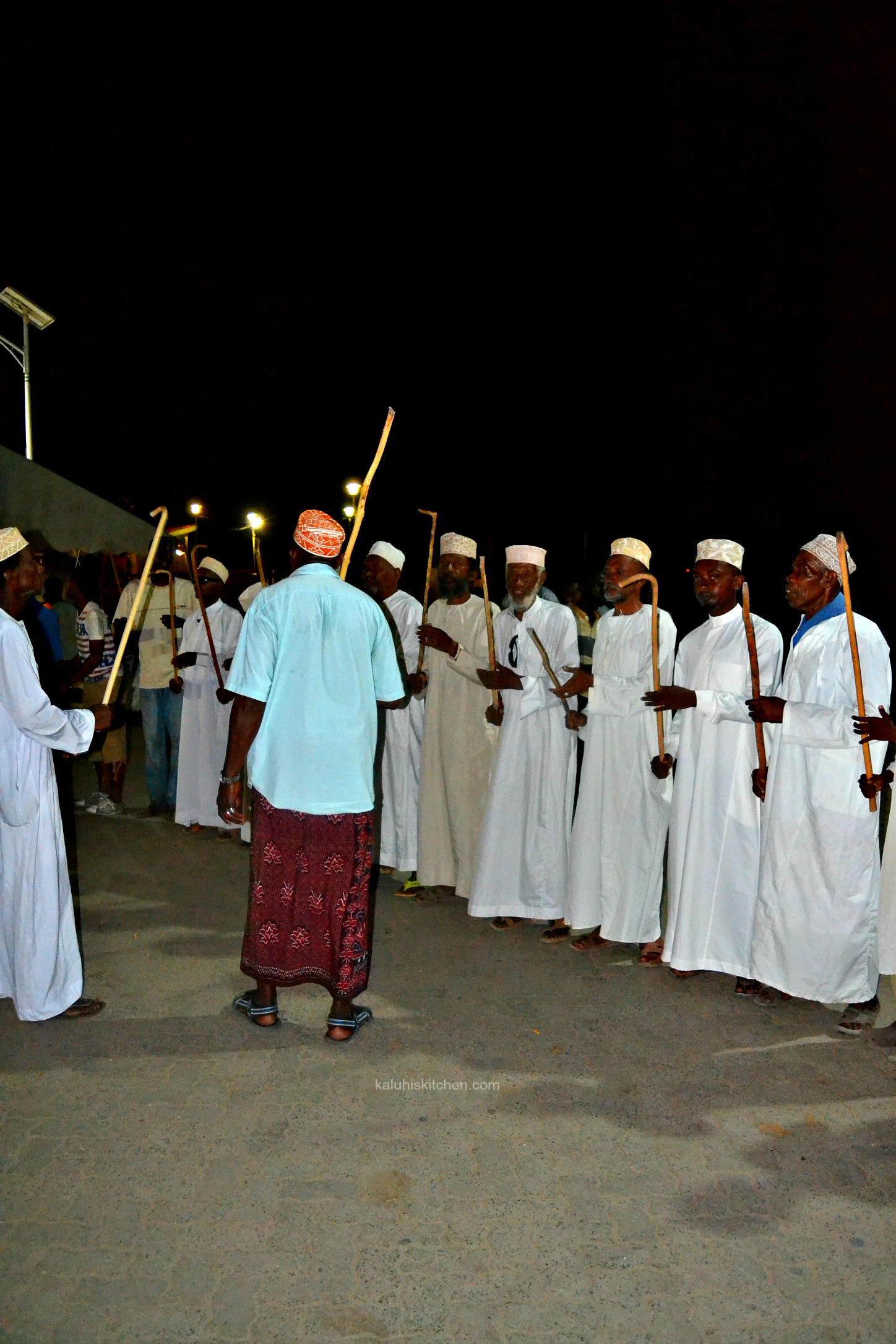 LOCAL RESIDENTS, MOSTLY MEN, LINE UP THE LAMU SEA FRONT AND SING SONGS THAT speak of teh heritage of lamu county_kaluhiskitchen.com